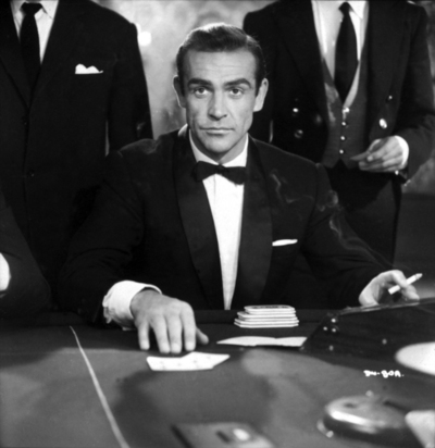 James Bond (Sean Connery) at the Chemin de Fer table at the 'Le Cercle' casino.