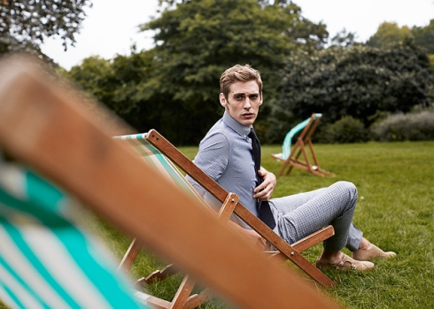 In Hyde Park: : blue cotton-gingham button-down collar shirt with navy broken-stripe silk jacquard tie, grey distorted-check wool trousers and milkshake suede double monk shoes